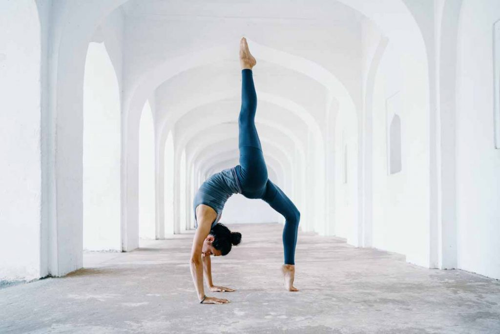Woman doing yoga pose - essential oils for yoga